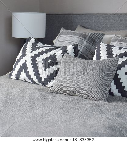 Graphic Style And Grey Shade Pillows On Classic Color Bedding Set Up