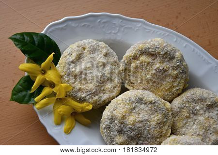 Champignons stuffed with a mixture of cheese and sausage covered with in bread crumbs and flour.