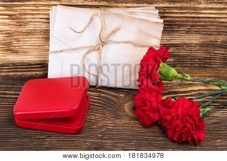 George's ribbon on the table with a red box and flowers a beautiful victory card