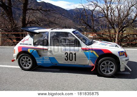 Castelvecchio di Rocca Barbena Italy - March 02 2014 - Eighth rally Historical Of Imperiesi Valli: The Peugeot 205 Turbo 16 crew Albini-Moretti at the start of the special stage called Melogno timed speed.