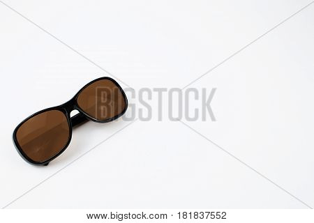 A pair of brown sunglasses on a white background