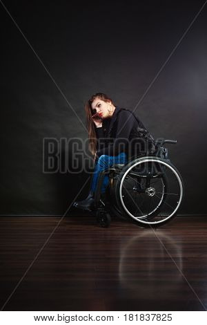 Sad Girl Sitting On Wheelchair.