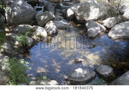 stream of the Serradilla route, in Piedralaves, Avila, Spain
