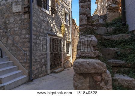 TRIBUNJ, CROATIA - SEPTEMBER 6, 2016: This is one of the alleys of the old historic part of the small Croatian seaside town.