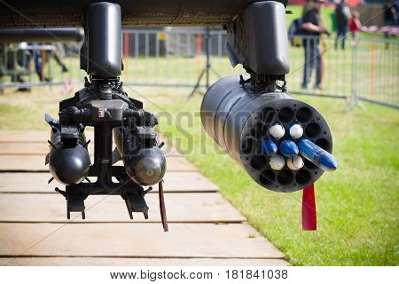 dummy rockets under an AH-64 apache helicopter