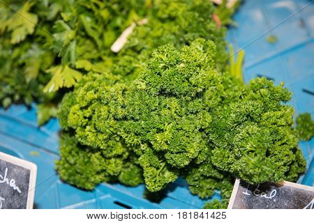 frizzy parsley in a transport box at the weekly market