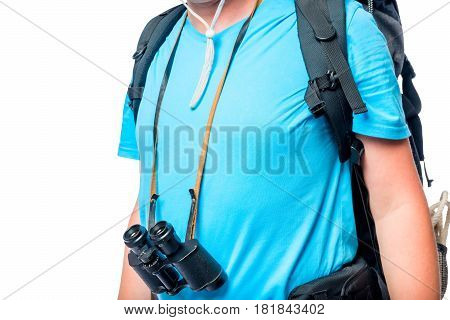 The Tourist's Chest With A Backpack And Binoculars Close-up