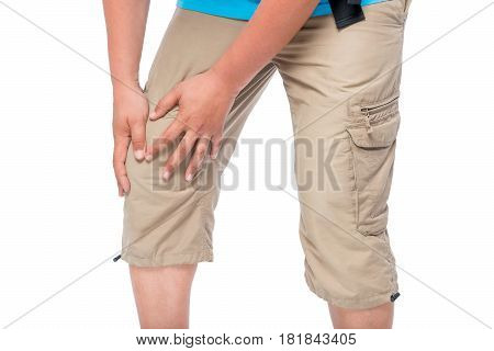 Knee pain male hands clasped knee close-up isolated