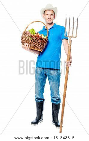 Farmer With A Pitchfork And A Basket Of Vegetables In Full Length In The Studio
