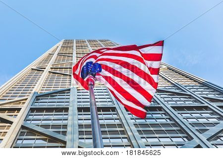 American Flag With Modern Skyscraper On Background