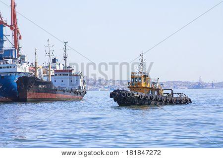 Trade port, Baku, Azerbaijan - March 29, 2017. Fire the ship enters the port.