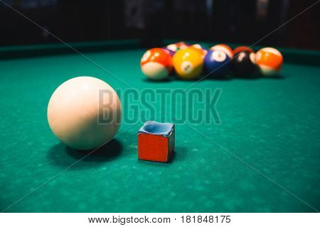 Ball And Chalk On The Billiard Table