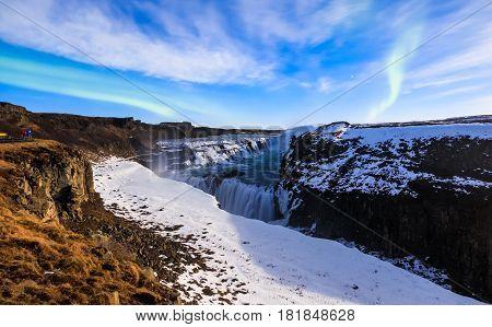 Gullfoss waterfall with Aurora borealis at night in full moon light Iceland