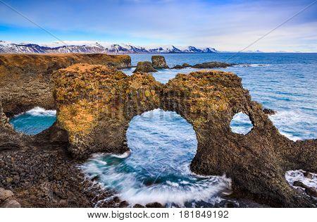 Natural rock gate in Arnarstapi Snafellsnes peninsula Iceland