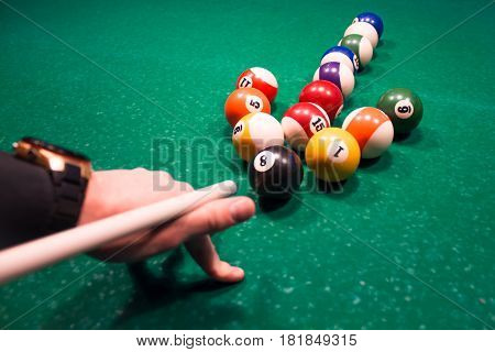 The Young Man Is Hitting The Arrow From The Billiard Balls In The Opposite Direction. The Concept Of