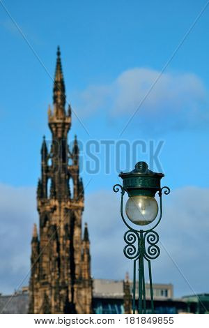Scott Monument, vintage lamp and Edinburgh city view in United Kingdom.