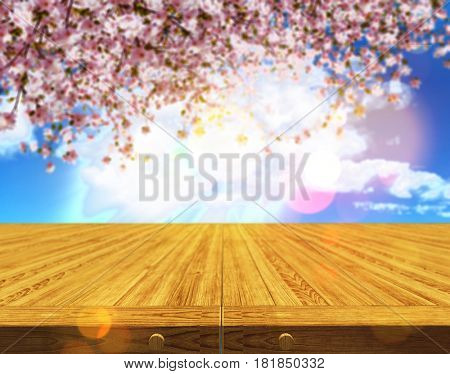 3D render of a wooden table against a defocussed cherry tree blossom background