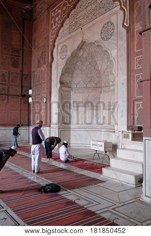 DELHI, INDIA - FEBRUARY 13: People praying at the Jama Masjid Mosque on February 13, 2016, Delhi, India.