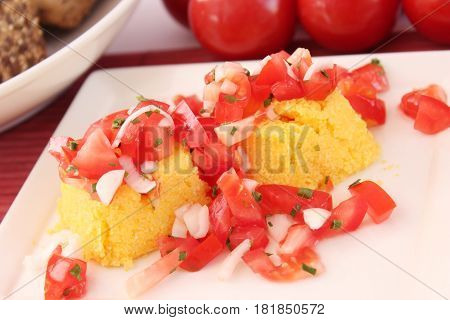 some couscous with a salad of tomatoes and onions