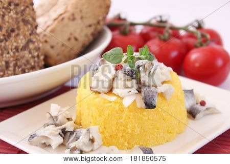 some couscous with a salad of fish and onions