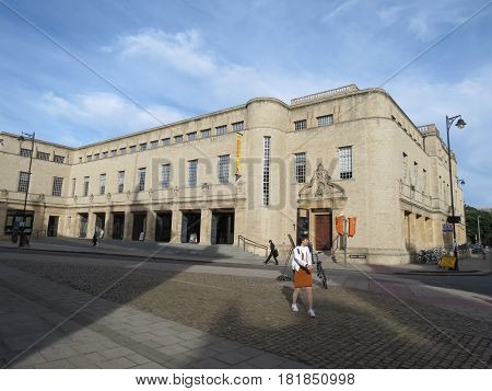 OXFORD UK - CIRCA SEPTEMBER 2016: Bodleian Library Weston Library building in Oxford with Asian girl crossing the street