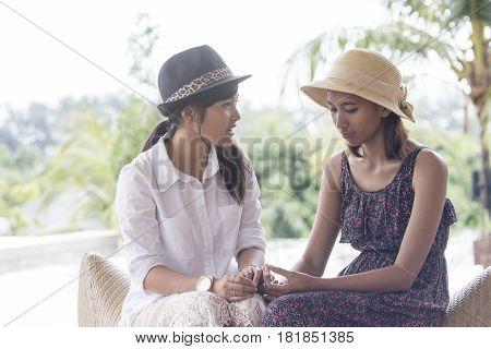 portrait of asian younger woman friend serious talking