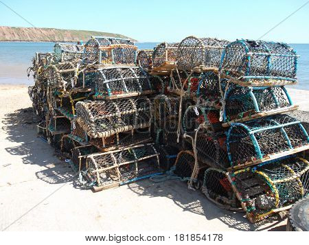 Crab or lobster cages with Filey Brigg in the background on the Yorkshire coast