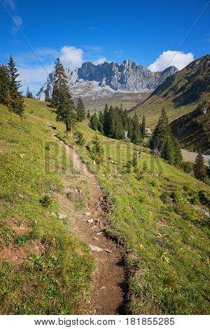 hiking path in swiss alpine landscape canton grisons