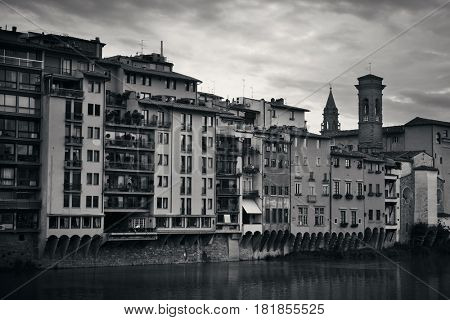 Italian style old buildings along Arno River in Florence, Italy in black and white