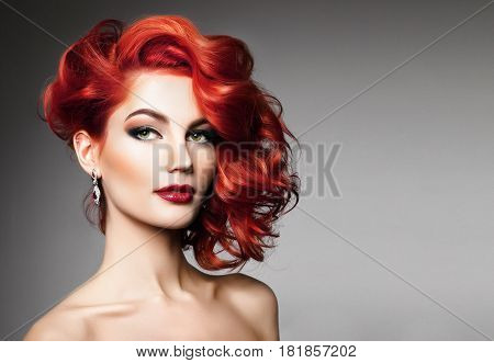 Portrait of beautiful sexy girl with red hair styling and professional makeup. Luxury slender woman.