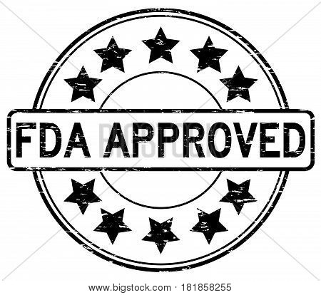 Grunge black FDA approved with star icon round rubber seal stamp on white background