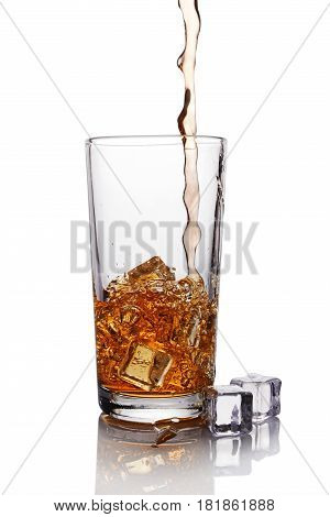 Pouring Black Tea In Glass With Ice Cube