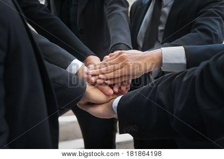 Business People Joining Hands Showing Teamwork