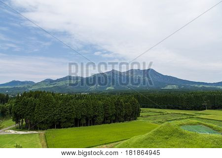 Mount Aso Volcano And Green Field In Kumamoto, Japan