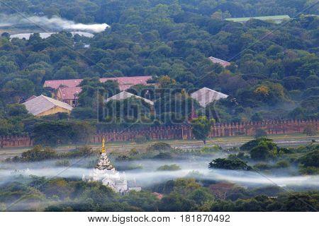 Mandalay with lake mountains, temples and pagodas seen from mandalay hill at sunset, Burma.