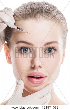 Cosmetic injection to female face isolated on white background
