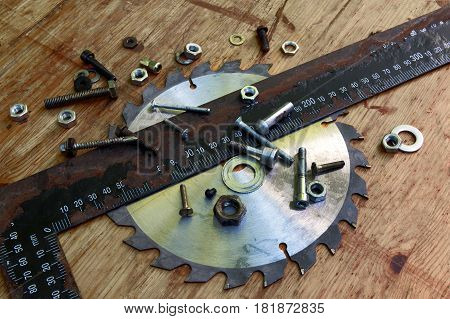 Nuts bolts screws ruler and disk for circular saw