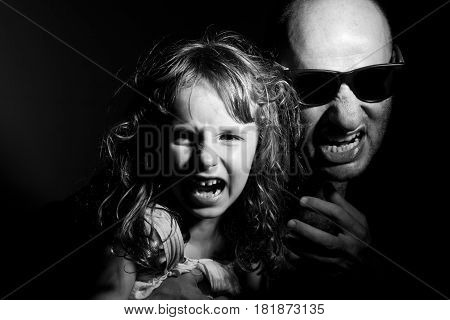 Father and daughter in gang style, dark light