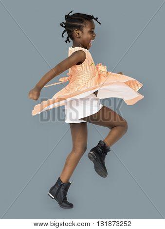 African little girl playful dancing studio portrait