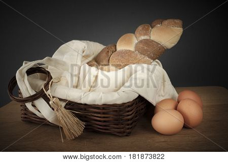 Braided Bread In A Wicker Basket And Eggs On The Table