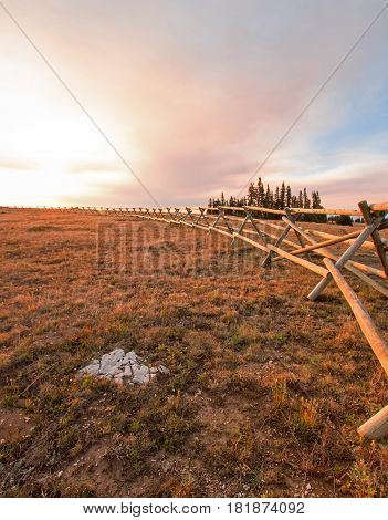 Split Rail Fence at sunrise above Lost Water Canyon in the Pryor Mountains on the Montana Wyoming state line USA