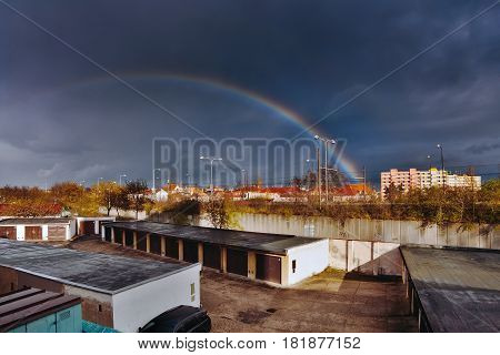 Chomutov, Ustecky Kraj, Czech Republic - April 07, 2017: Rainbow Over Garages And Road Number 13 At