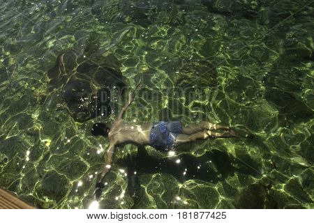 Swimming in crystal clear turquoise blue water, Kas, Turquia