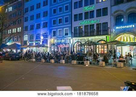 Munich Bavaria Germany- 29th March 2017. People drinking beer on terraces of bars on Tal Street next to the Marienplatz