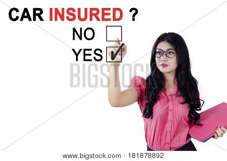 Image of female worker holding a pen and document while agreeing about car insured isolated on white background