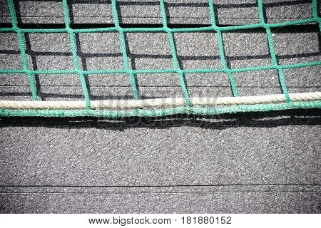The close-up of stacked Styrofoam plates for heat insulation of a building which are fixed with a net.
