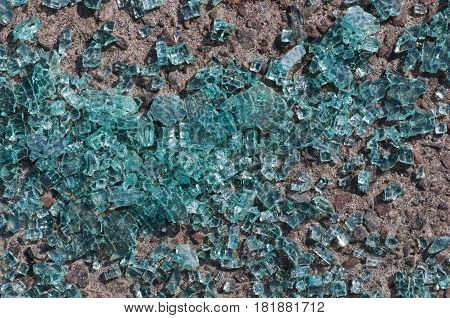 Finely broken glass lying on the ground, ecology.