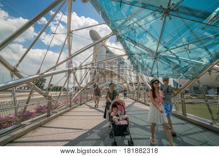 Family Tourist On Helix Bridge In Marina Bay, Singapore