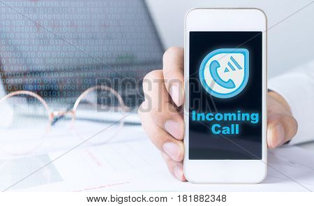Business man using Internet VOIP on smartphone