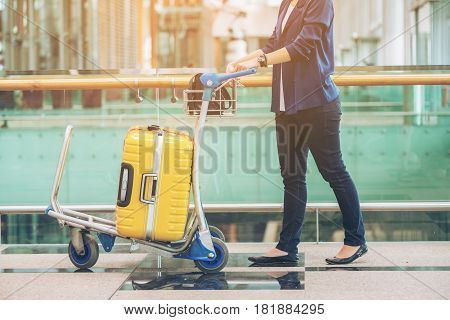 Tourist Woman In The Airport Terminal With Luggage